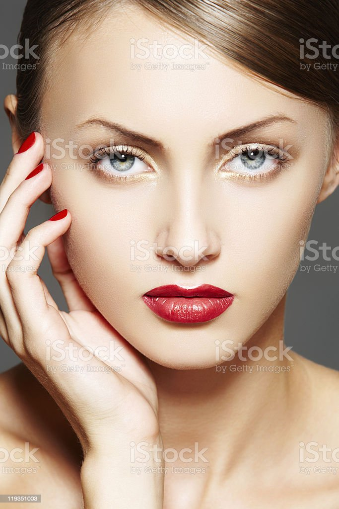 Luxury woman model with juicy red lips and manicure stock photo