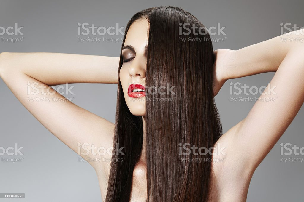 Luxury woman with chic long hair and clean skin relaxing stock photo
