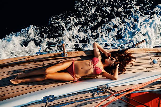 luxury woman yachting in sea top view - foto de stock