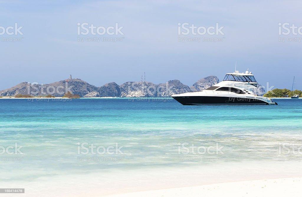 Luxury yacht at the beach stock photo