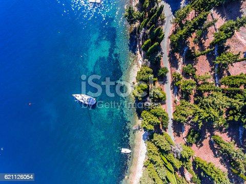 istock Luxury yacht docked near the cliff, on Corfu Island, Kerkyra, 621126054