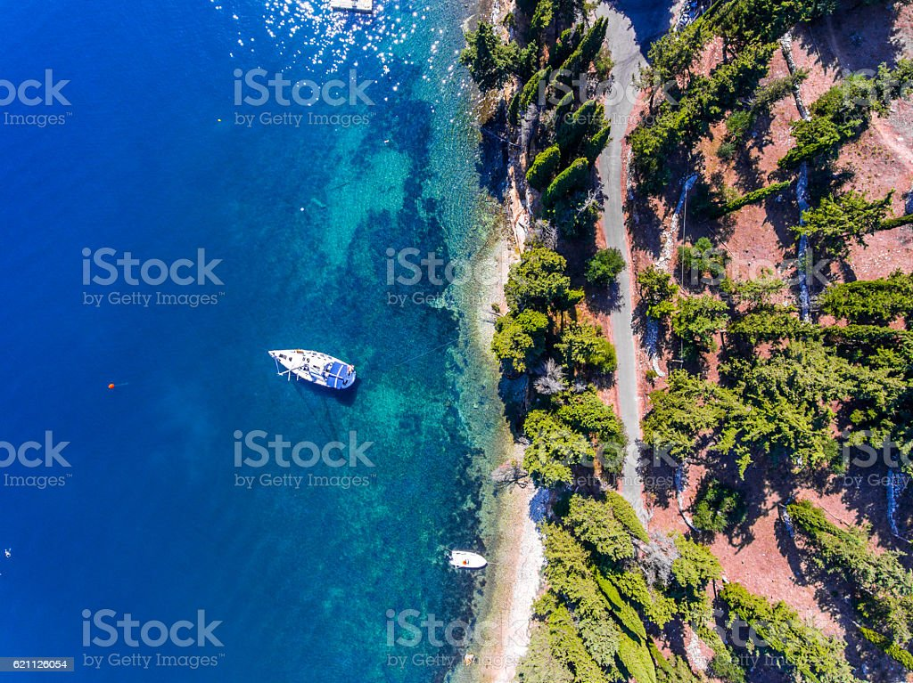 Luxury yacht docked near the cliff, on Corfu Island, Kerkyra, стоковое фото