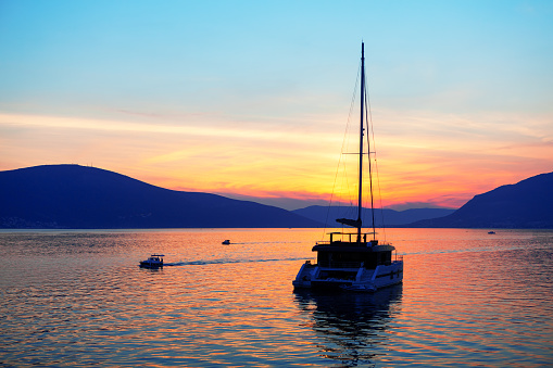 Luxury yacht in the dusk . Twilight over the bay . Millionaire yacht