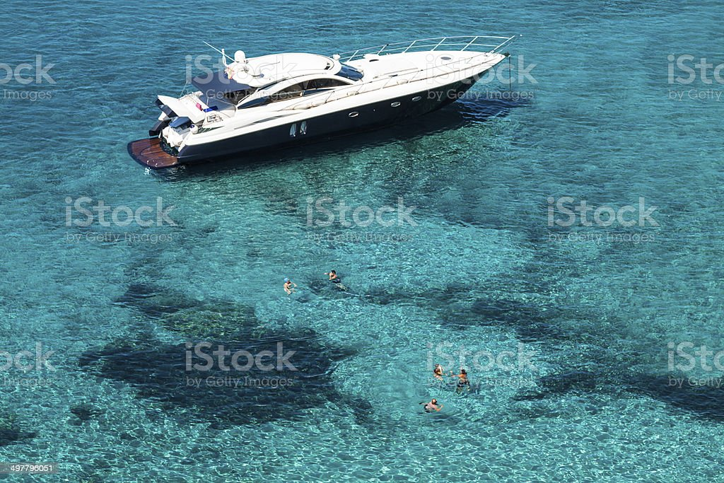 luxury yacht in turquoise Illetes Formentera mediterranean sea B stock photo