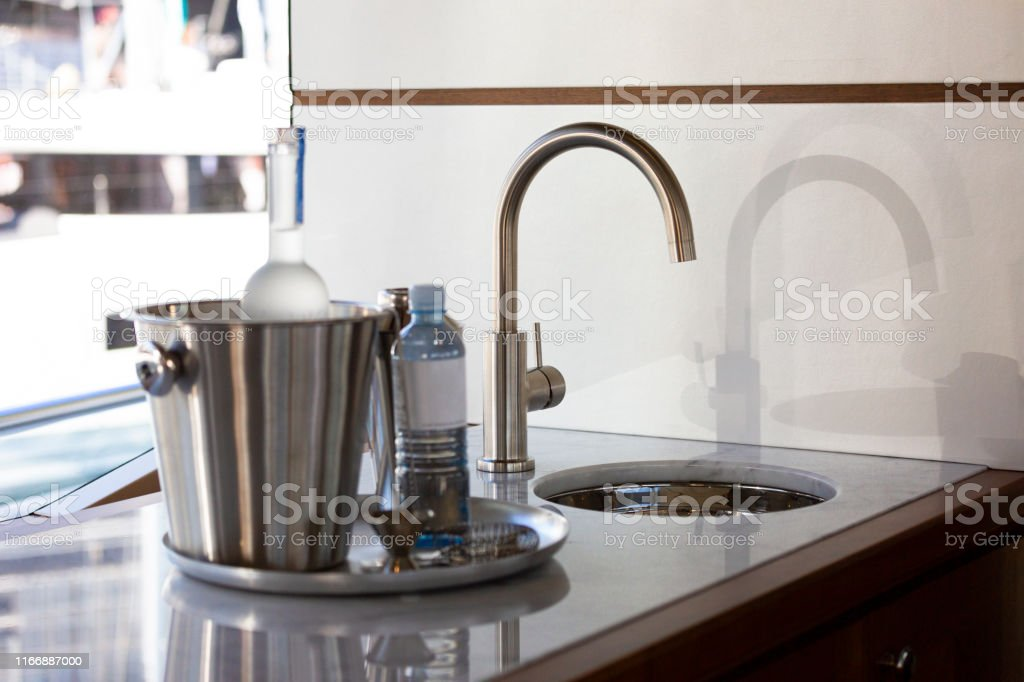 Luxury Yacht Kitchen Sink And Bucket With Bottle Of Wine And Water