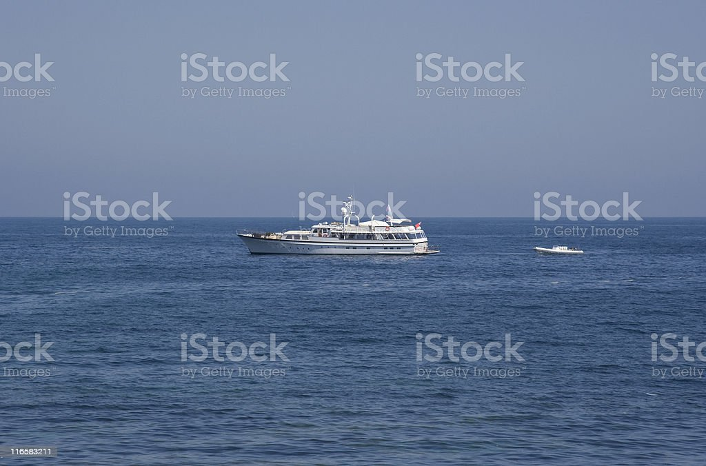 luxury yacht pulling a lifeboat royalty-free stock photo