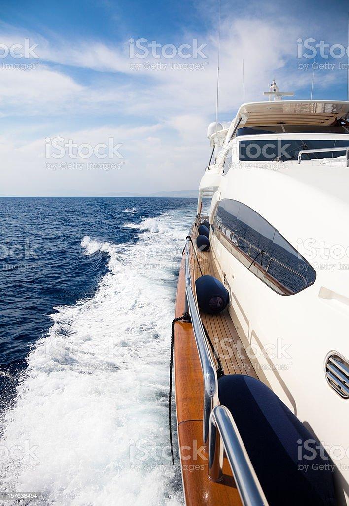 Luxury yacht sailing at sea stock photo