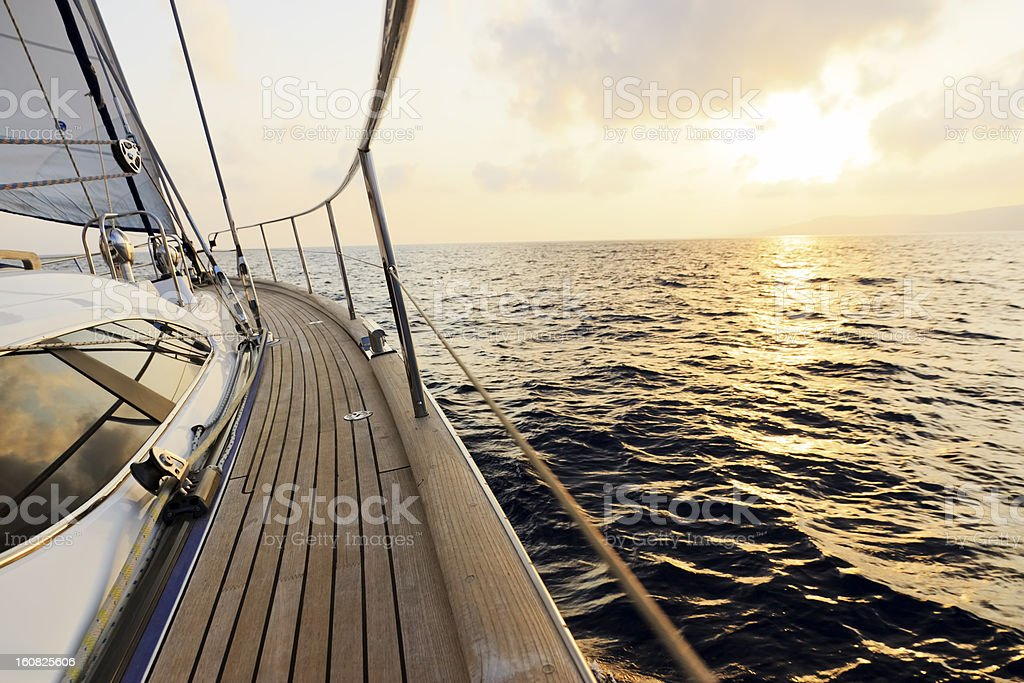 Luxury yacht sailing at sunset stock photo