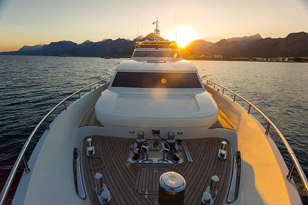 Luxury yacht sailing on the sea during sunset stock photo