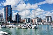 istock Luxury yachts and apartments at Southampton's Ocean Village marina 683402330