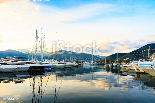 istock Luxury yachts and motorboat in marina. 947833294