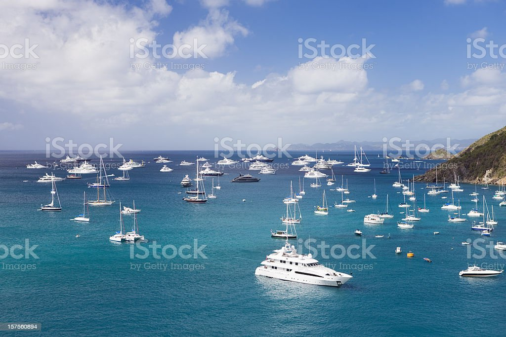 luxury yachts at anchor in the Caribbean harbor stock photo