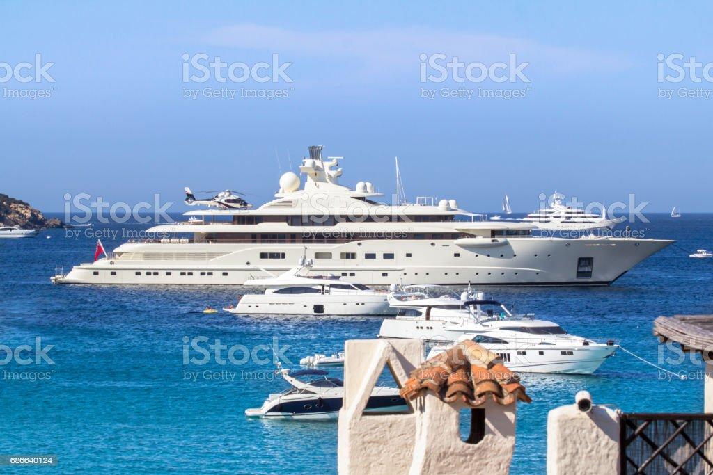 Luxury yachts at Porto Cervo bay at Sardinia Island, Italy stock photo