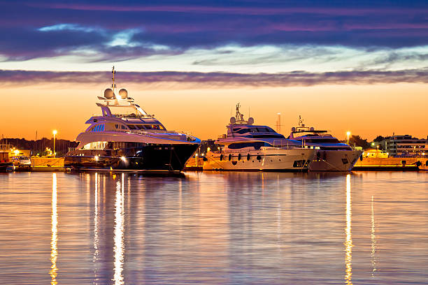 luxury yachts harbor at golden hour view - segelyacht stock-fotos und bilder