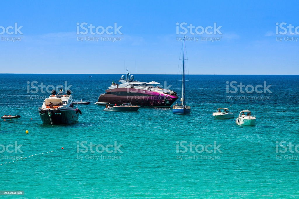 Luxury yachts in turquoise beach of Formentera Illetes royalty-free stock photo