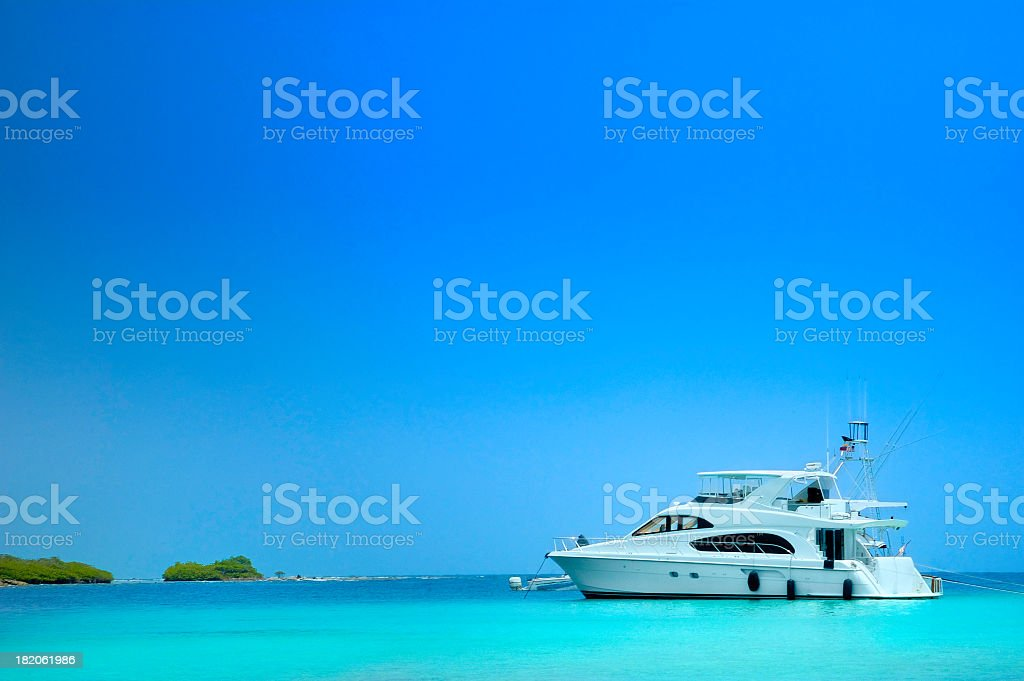 Luxury Yachts sailing in a tropical exotic island beach stock photo