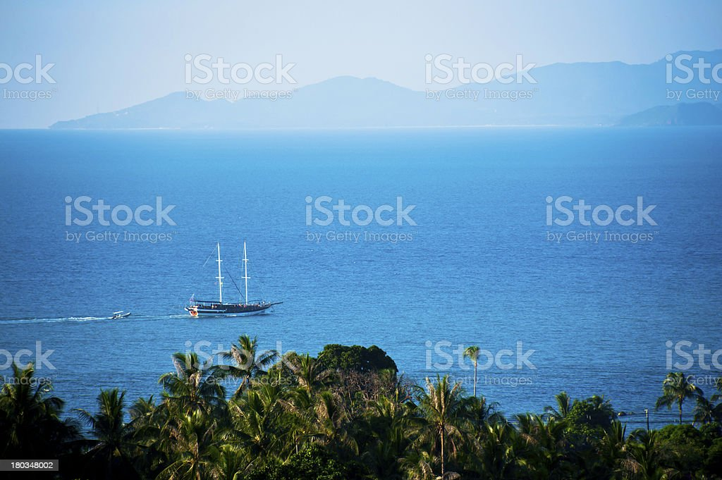 Luxury yatch in open waters and mountain royalty-free stock photo