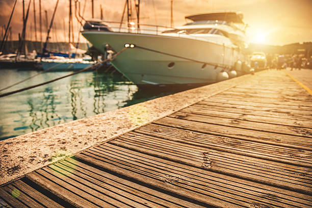 luxury yatch in port - aangemeerd stockfoto's en -beelden