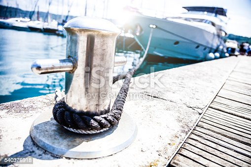 Luxury Yatch in port, selective focus on the pier.