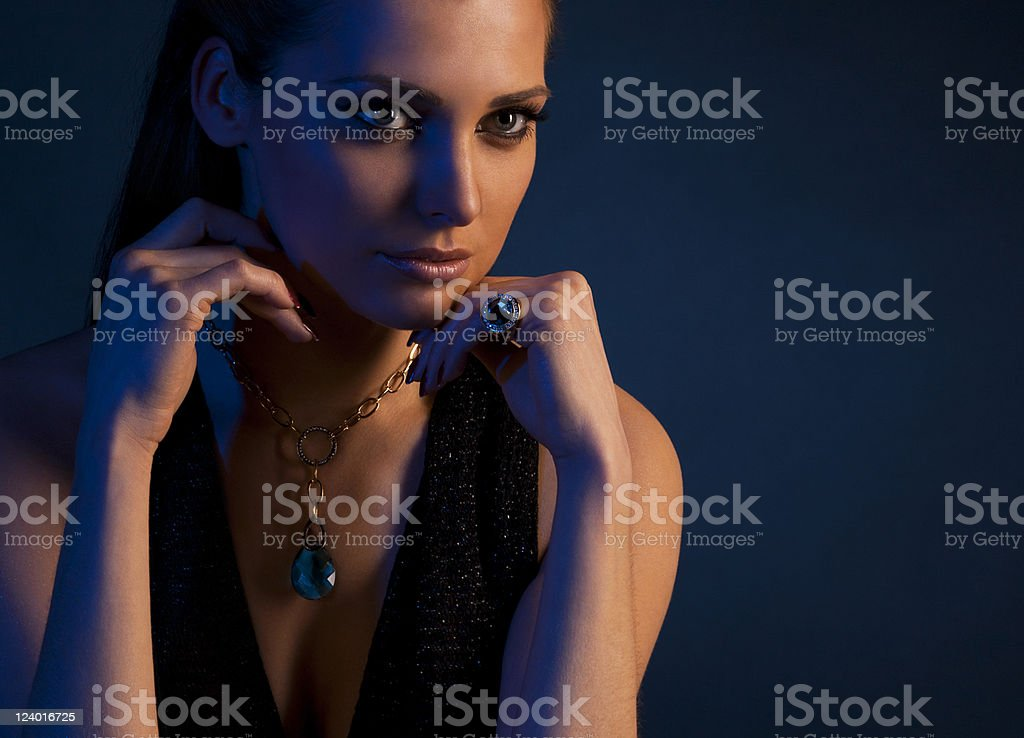 luxury young dark-haired girl in exclusive jewelry royalty-free stock photo