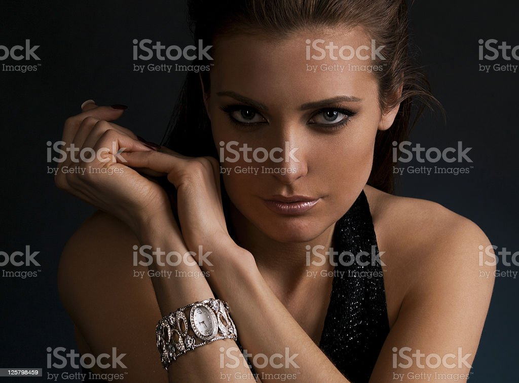 luxury young dark-haired girl in exclusive jewelry wrist watch stock photo