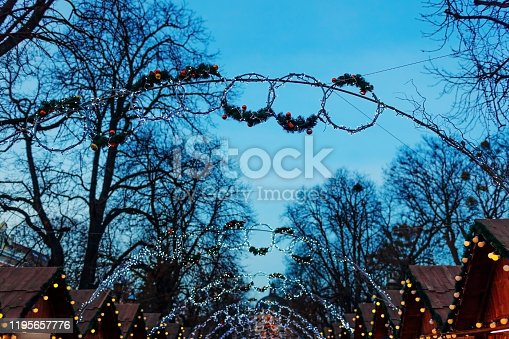 istock Lviv Christmas fair 2019. New year decorations hung outdoors. Illuminated stores and trees. Holidays 1195657776