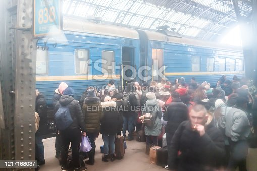 Lviv, Ukraine - December 28, 2019: Architecture high angle view of Lvov train station platform in historic Ukrainian city with crowd of people standing boarding