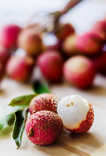 Lychee fruit on a wooden board stock photo