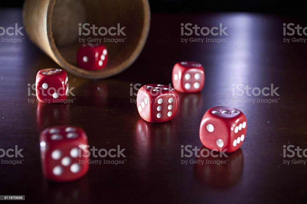 lying Dice cup and dices stock photo