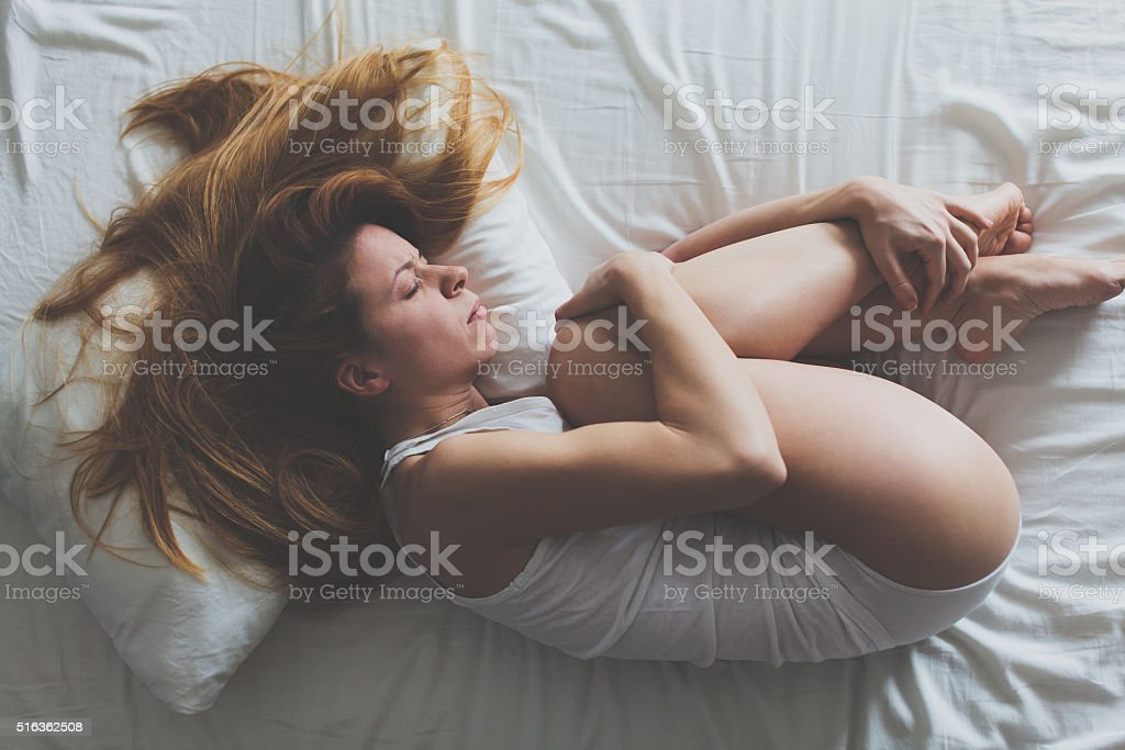 Lying down and sad stock photo