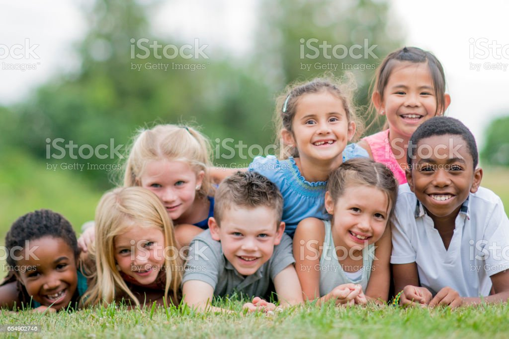 Lying in a Dog Pile stock photo