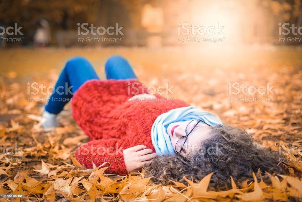 Lying in fallen leaves stock photo