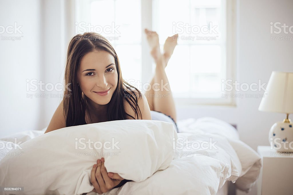 Lying in the bed stock photo