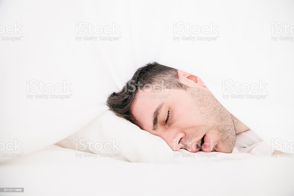 Lying in the sheets stock photo