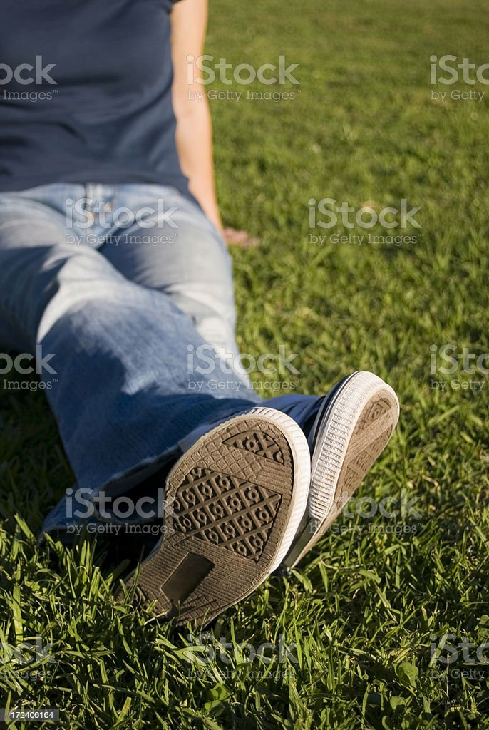 Lying on grass royalty-free stock photo