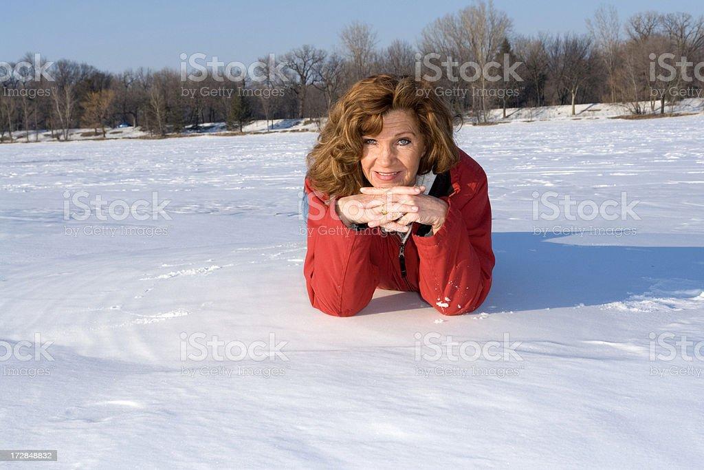 Lying on snow royalty-free stock photo