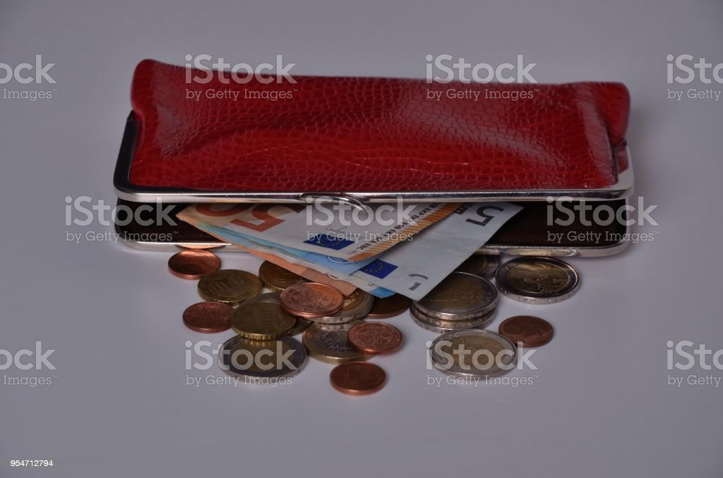 Lying red wallet and some Euro bills and coins stock photo