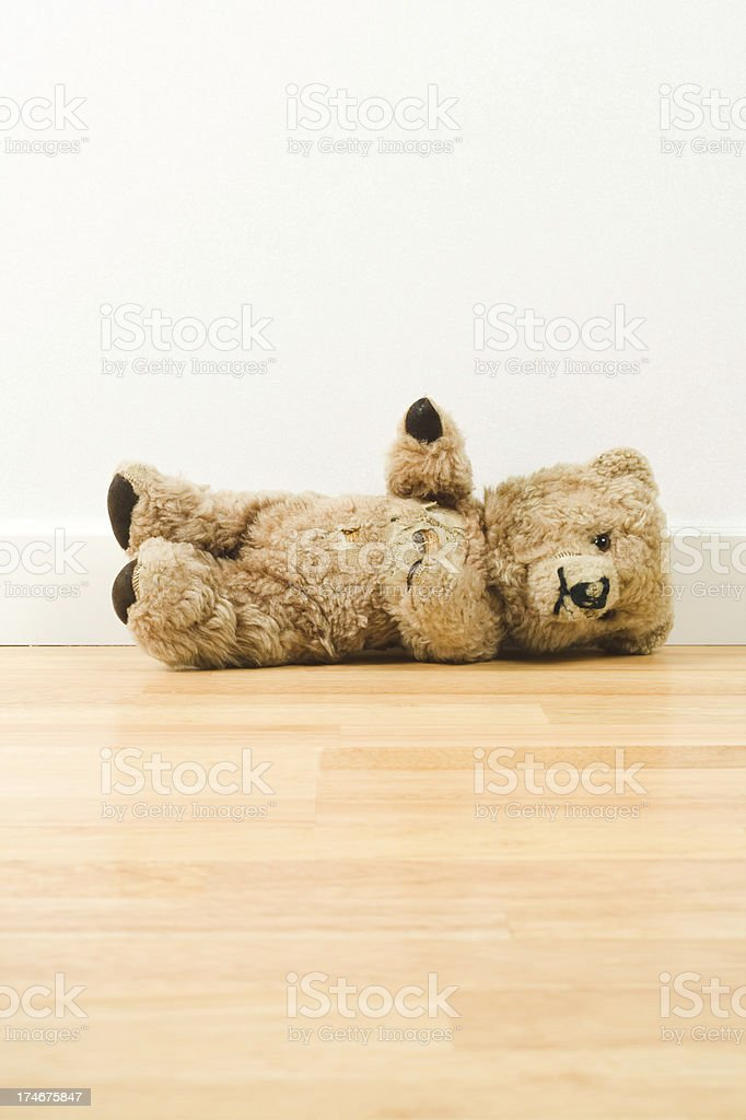 Lying teddy bear stock photo