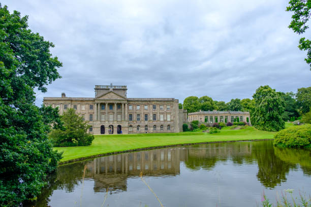 Lyme Hall historic English Stately Home and park in Cheshire, UK with people enjoying themselves in the gardens stock photo