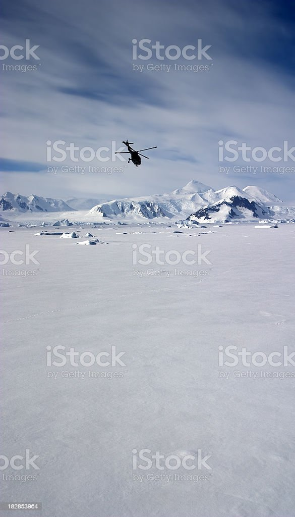 Lynx Helicopter Flying over Sea Ice stock photo