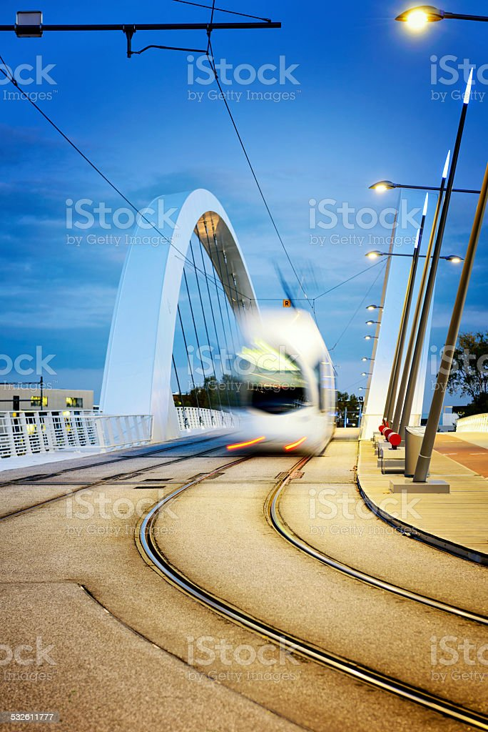 Lyon city and tramway on the confluences bridge stock photo