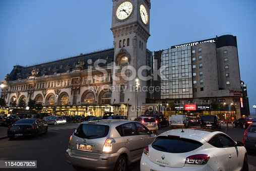 The Gare de Lyon is one of the six large mainline railway station termini in Paris, France. It handles about 90,000,000 passengers every year, making it the third busiest station of France. The station was built for the World Exposition of 1900. The Image shows a main Entrance to the Train Station.