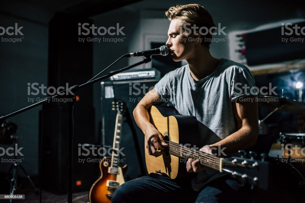 Lyric singer with acoustic guitar. stock photo