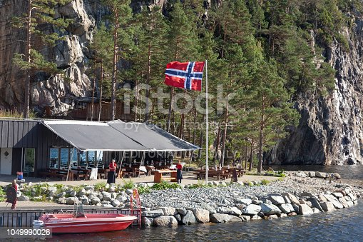 Lysefjord-Helleren restaurant on the Magnificent Lysefjorden. Travel stop along the Lysefjord tour boat cruise. Staff was waiting to serve snack of waffles and coffee on this breezy afternoon.