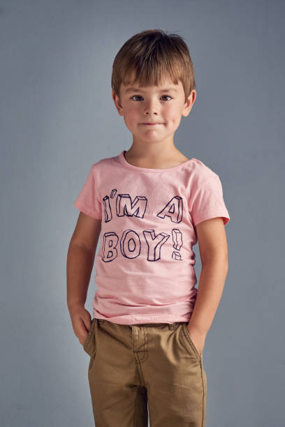 i'm a boy who's proud to wear pink - gender stereotypes stock photos and pictures