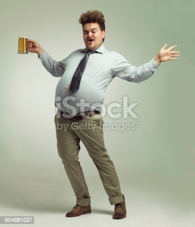 Shot of an overweight man celebrating while holding a pint of beer