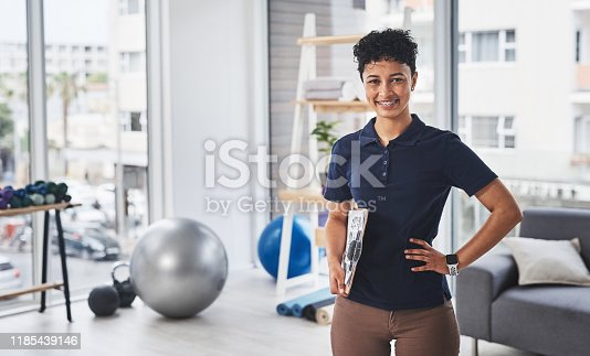 Portrait of a young and confident physiotherapist posing inside her office at a clinic