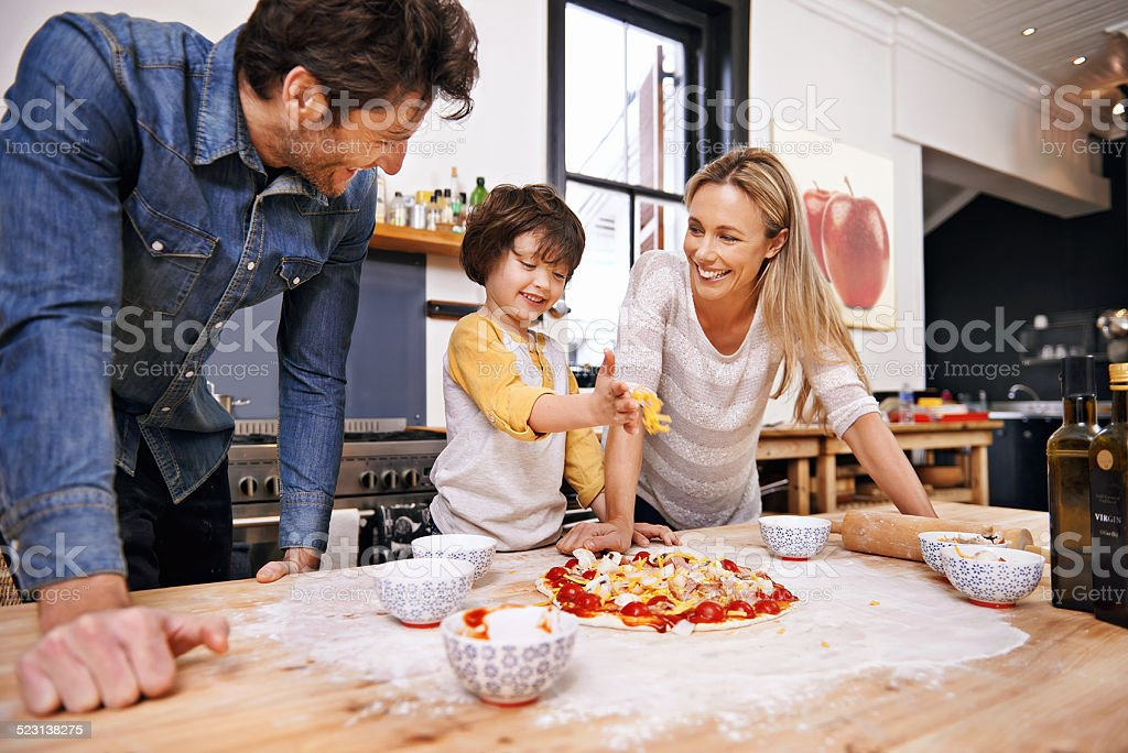 I'm adding all the toppings! stock photo