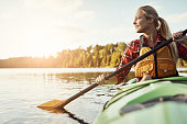 Shot of an attractive young woman out for canoe ride on the lake