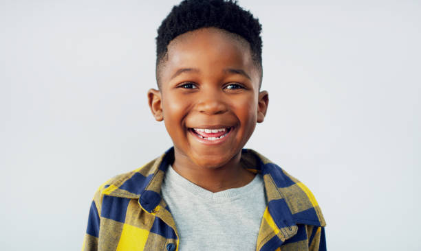 I'm always ready to have some fun Portrait of an adorable little boy posing against a white background 8 9 years stock pictures, royalty-free photos & images